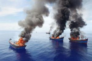 A dramatic message from the island of Palau: illegal fishing boats burning, in June 2015. (Photo: National Geographic)