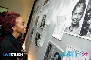 Viewing the gallery of honorees. (Photo: WE-Change)