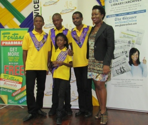 BIAJ Chair Latoya West-Blackwood joined last year's National Reading Champions for a photo op at the Jamaica Library Service headquarters. This year, Fontana Pharmacy and the Sandals Foundation came on board as new private sector sponsors.