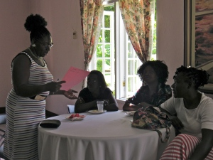 Irene Moore (standing) discusses human rights issues with the women on her table in Portland. (My photo)