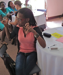 A participant makes a strong point at the 51% Coalition/Fi Wi Jamaica session in Fairy Hill, Portland. (My photo)