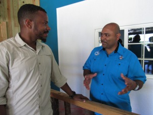 BirdLife Jamaica President Damany Calder of the National Environment and Planning Agency (NEPA) (left) chats with Research Officer Dr. Dayne Buddoo at the launch of the Alligator Head Foundation. (My photo)