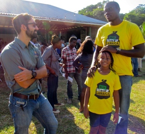 Jonathan Hernould (left) Environmental Officer at  Sandals Foundation chats with Jamaica Environment Trust. (My photo)