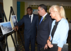 Minister without Portfolio in the Ministry of Economic Growth and Job Creation Daryl Vaz (centre), and Mission Director for the United States Agency for International Development (USAID) in Jamaica, Denise Herbol (right), are shown an exhibit by Meteorological Officer at the Meteorological Service, Jamaica (MSJ), Rohan Brown, during a forum to mark World Meteorological Day, under the theme: 'Hotter, Drier, Wetter. Face the Future'. (Photo: Jamaica Observer)