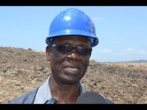 Minister McKenzie at Riverton City. Is he expecting some garbage to land on his head I wonder? (Photo: Jamaica Gleaner)