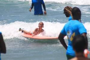 Sheer enjoyment: An autistic child has a wonderful time at the recent Surfing for Autism event organized by the Jamaica Surfing Association. (Photo: Facebook)