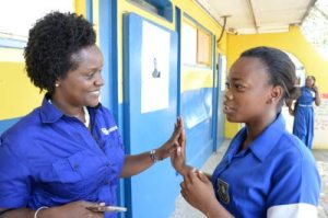 Dr Renee Rattray (left), director, education programmes, at the JN Foundation, has words of encouragement for Sha-Ann Clarke, a first-former at Jonathan Grant High School, during Girls' Empowerment Day.  (Photo: Jamaica Observer)