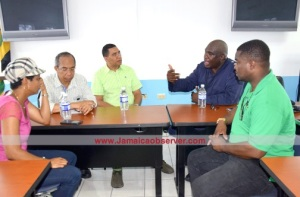 (l-r) Members of Parliament Marlene Malahoo Forte, Horace Chang, Prime Minister Andrew Holness, SSP Steve McGregor and MP Heroy Clarke thrash things out in Montego Bay. (Photo: Alan Lewin/Jamaica Observer)