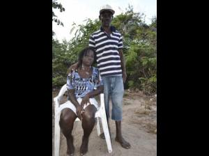 The grieving parents of eight-year-old Kemeisha Butler, who died on March 8. The cause of her death isn't known at this time. (Photo: Jamaica Star)