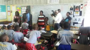 Minister of Education Ruel Reid (far left) touring Padmore Primary School last year.