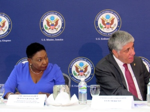 Gender Affairs Minister Olivia Grange and U.S. Ambassador to Jamaica Luis Moreno listen closely at the launch of the Domestic Violence Project last week. (My photo)