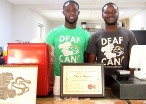 Fabian Jackson (left) and chief barista Carlyle Gabbidon, whom we met at Deaf Can! Coffee this week. (My photo)