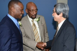 Minister of State in the Ministry of Finance and the Public Service, Hon. Rudyard Spencer (centre), greets Japan's Ambassador to Jamaica His Excellency Masanori Nakano (right), while Director, Sanmerna Foundation Limited, Mark White, looks on at the launch of the Sanmerna Foundation on Wednesday at the University of the West Indies. (Photo: Jamaica Information Service)