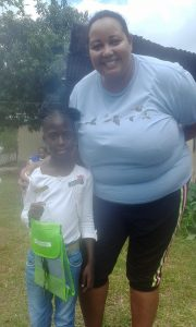 NEPA trainer Ava Tomlinson with the champion birder for the day, Rihana Holder of Bohemia All Age School, at a special event in Trelawny today. (Photo: Facebook)
