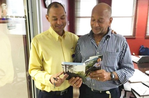 Former GraceKennedy Chairman and CEO Douglas Orane (right), formally presents his book, The Business of Nation Building, to GraceKennedy Group CEO Don Wehby. (Photo: Jamaica Observer)