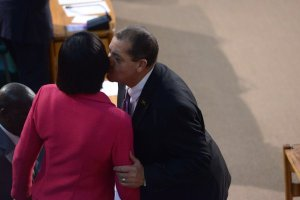 Finance and Planning Minister Audley Shaw kisses Opposition Leader Portia Simpson Miller in the House of Representatives. (Photo: Gleaner)