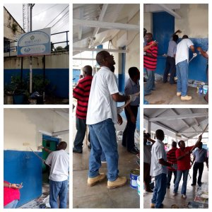 Member of Parliament for East Portland Lynvale Bloomfield gets to work on painting the police station on Labour Day - when huge amounts of paint are bought, all over the island! (Photo: Twitter)
