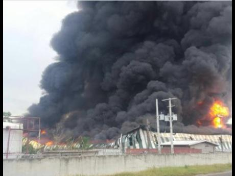 "A huge fire destroyed the 260,000 sq. ft. warehouse at Wisynco in Lakes Pen, St. Catherine. It started on Thursday afternoon and took many hours to bring  under control. Wisynco head William Mahfood tweeted:""I want to thank all Jamaica and our great people for the outpouring of well wishes and love. We will rise and have much to be thankful for."" (Photo: Gleaner)"
