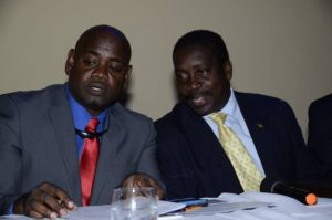 Minister of National Security, Hon. Robert Montague, in discussion with Chairman of the Jamaica Police Federation, Sergeant Raymond Wilson, at the Federation's 73rd Annual Joint Central Conferences at the Hilton Rose Hall and Spa, in St. James on May 11. (Photo: JIS)