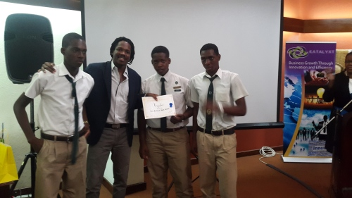 Guest Speaker Damion Crawford with the winners, Vere Technical High School.