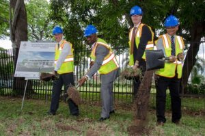 Hard hats and shovels! Minister of Energy, Science and Technology, Dr. Andrew Wheatley (2nd left); participates in the breaking of ground for construction of the Caribbean's first Net Zero Energy Building on the University of the West Indies' (UWI) Mona campus on May 10. Others (from left) are: Professor of Caribbean Sustainable Development at UWI, Professor Anthony Clayton; Senior Programme Manager, Energy, Climate and Technology Branch of the United Nations Environment Programme (UNEP), Kenya, Geordie Colville; and Emeritus Professor of Chemistry at the UWI, Professor Tara Dasgupta. (Photo: JIS)