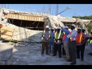Minister of Local Government and Community Development, Desmond McKenzie (centre), and technical officers from the ministry and representatives of the Royalton Negril Hotel view the collapsed section of the property during a tour on Friday. (Photo: Gleaner)