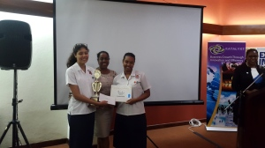 Second place winners Campion College accept their prize from Katalyxt founder Winsome Minott.