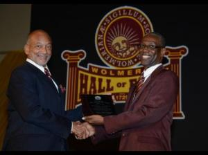 Lincoln McIntyre (right), chairman of the Wolmer's School Board, makes a special presentation to Douglas Orane, chairman of the Wolmer's Trust Infrastructure Committee, during last Friday's launch and inaugural induction of the Wolmer's Hall of Fame held at the Wolmer's Boys' High School Auditorium at Heroes Circle in Kingston. (Photo: Gleaner)