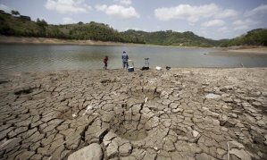 A man and a boy try to fish while standing on the dry shores of the almost empty La Plata reservoir in Toa Alta, Puerto Rico. Photograph: Alvin Baez/Reuters