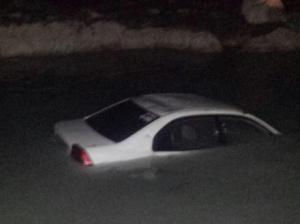 The Jamaica Constabulary Force is still searching for a man who drove into the sea at Discovery Bay, St. Ann yesterday evening. He is feared drowned. Police equipment was found in the car. (Photo: Gleaner)
