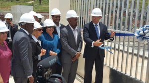 What do they expect might fall on their heads, I wonder? PM Andrew Holness, Technology Minister Andrew Wheatley, JPS CEO Kelly Tomblin and others wear the correct headgear as Wigton Wind Farm Phase 3 is officially opened. (Photo: PM's Twitter)