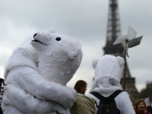 Climate change activists hug in front of the Eiffel Tower in Paris, during last year's Conference on Climate Change.