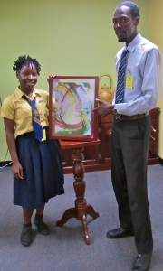 Ebonique poses with her painting - and grade teacher Mr. Marlon Richards. (My photo)