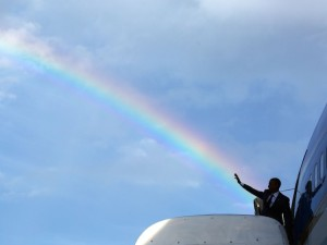 Another famous rainbow in Jamaica: President Obama waves goodbye from Air Force One in this photograph by Pete Souza.