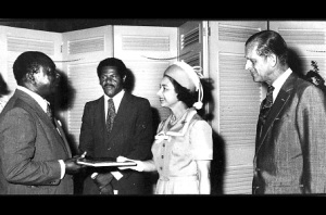 Publisher and editor of Spotlight magazine, Evon Blake (left), presents a specially bound copy of his magazine to Her Majesty Queen Elizabeth 11 at King's House during her visit to Jamaica in 1966. Looking on are Prince Philip, Duke of Edinburgh (right), and Ken Chaplin, chief media coordinator. (Photo: Jamaica Observer)