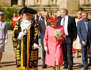 The Queen believes in matching hats and coats at all times. Here she is visiting Birmingham during her Diamond Jubilee, accompanied by a man in a crazy hat (one presumes he's the Mayor). (Photo: West Midlands Police)