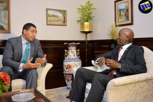 Prime Minister Andrew Holness (left), in dialogue with Prime Minister of the Republic of Trinidad and Tobago, Dr. Keith Rowley, during his visit. (Photo: JIS)