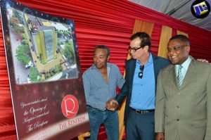 Director of Tourism, Paul Pennicook (right), looks at the design for The Renfrew at the launch of the hotel project in New Kingston on July 18. Architect Evan Williams (left) and Chief Executive Officer (CEO) of Downsound Records, Josef Bogdanovich, are the partners in the project. (Photo: JIS)