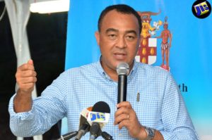 Minister of Health, Dr. Christopher Tufton addresses Town Hall Meeting announced that Jamaica will shortly be participating in a number of clinical trials with a view to finding a vaccine to treat the Zika Virus. (Photo: JIS)