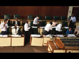 A malfunctioning AC unit due to low voltage forced Senators to remove some of their clothing in Parliament yesterday. (Photo: Gleaner)