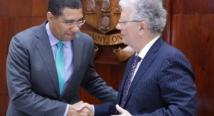 Prime Minister Andrew Holness shakes hands with French Ambassador to Jamaica