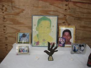 Fifteen year-old Jason Smith was shot and killed by police in Spanish Town on July 9, 2002. Here is a photo of the table set up at the memorial over the weekend, taken by Susan Goffe.