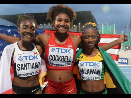 Jamaica's Shannon Kalawan (right), the silver medal winner in yesterday's women's 400 metres hurdles, posing with gold medallist Anna Cockrell (centre) of the United States and Xahria Santiago of Canada who came third in the event at the IAAF World Under-20 Championships in Bydgoszcz, Poland. At the end of Day 5, Jamaica has five medals, including two gold. (Photo: Collin Reid/Gleaner)