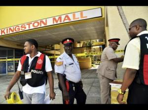 Investigators arrive at the scene of a murder-suicide in downtown Kingston. (Photo: Norman Grindley/Gleaner)