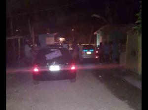 The police carry out an investigation in New Ramble, St. James last night. (Photo: Gleaner)