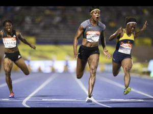 Elaine Thompson (centre) powers to a win in the women's 100m at the JAAA/Supreme Ventures National Senior Championships in 10.70 seconds. Christania Williams (right) finished second with Simone Facey coming fifth. (Photo: Ricardo Makyn/Gleaner)