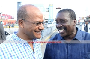 Opposition Spokesman and former Minister of National Security Peter Bunting (left) bonding with the current Minister Bobby Montague. (Photo: Joseph Wellington/Jamaica Observer)