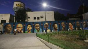 Dusk descends on the new mural depicting members of the Olympic Refugee Team. (Photo: Getty Images)