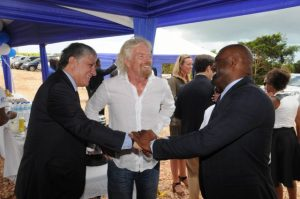 Minister of Science, Energy and Technology, Dr. the Hon. Andrew Wheatley (right), exchanges greetings with United States Ambassador to Jamaica, His Excellency Luis Moreno (left), while head of the Virgin Group, Sir Richard Branson, looks on. Occasion was the opening of Blue Mountain Renewables (BMR) Jamaica Wind Project in Potsdam, St. Elizabeth on August 11. (Photo: JIS)