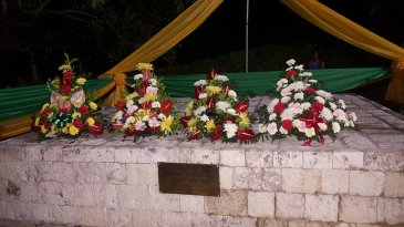 Remembrance: Flowers on the simple memorial at Seville Great House in St. Ann for enslaved African ancestors, during the Emancipation Jubilee celebrations over the weekend. (Photo: Ministry of Culture, Gender, Entertainment and Sport on Twitter).